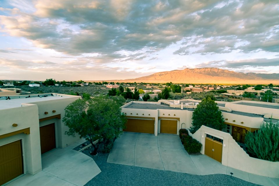 GORGEOUS VIEWS OF THE MOUNTAINS, CORRALES, DOWNTOWN AND THE VALLEY.  Impeccably Maintained, 4 bedrooms with a study.  Large Great Room that opens into Large Kitchen, Tons of Custom Maple Cabinets, Granite Counter Tops, Center Island Cooktop, Breakfast Bar and nook.  10 Zone Radiant Heat. Tall Ceilings with Vigas, Kiva Fireplace. Extra large detached garage could be used as workshop or RV garage.  You will love this well thought out functional Floorplan.