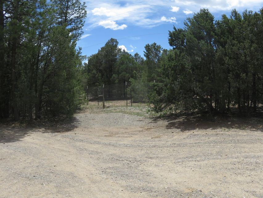 Fabulous  horse property- 3.45 acres- fenced-triple wide- 3 bedroom/2 bath manufactured home-wood burning stove-large country kitchen- comfy front room-family room-ceiling fans-island kitchen- pantry- double sink in master-beautiful treed property- hay shed or could house one-R.V. hookup-bay window in living room- two horses-RV hook up- gardens- lovely home with lots of room for animals!  Has hauled water-2 wells- 2 septic's-there is so much potential here! Circle driveway ask about the water for the horses, it's cool! Don't miss out on this home that is priced to sell. Beautiful country living but yet close to I-40