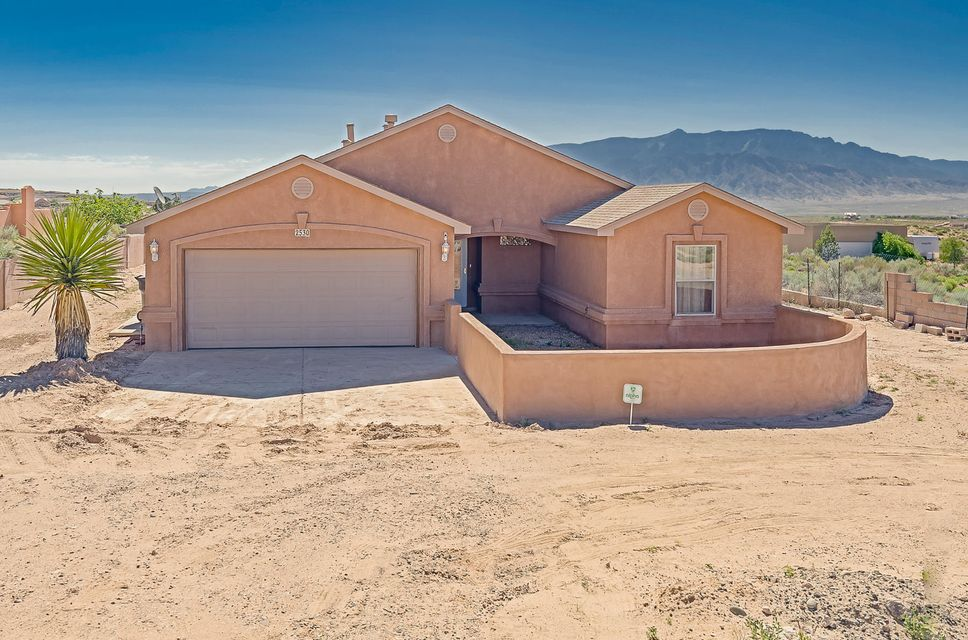 Price reduced on this home sweet home. Enjoy the feel of country living in Rio Rancho city limits. This comfortable 4 bedroom custom is graced with a large living area and kiva fireplace, a roomy kitchen that's open to the living room, tile in main rooms and carpeted bedrooms.  Appealing floor plan features the master bedroom on one end of house for privacy and 3 guest bedrooms on the other end.  Large master suite is a place to escape and renew. Embrace outdoor living on the east-facing covered rear patio with Sandia Mountain views, or relax in the front courtyard and watch the colorful New Mexican sunsets. Close to the highly rated Cleveland High School, shopping, dining, easy access to Albuquerque and Santa Fe.