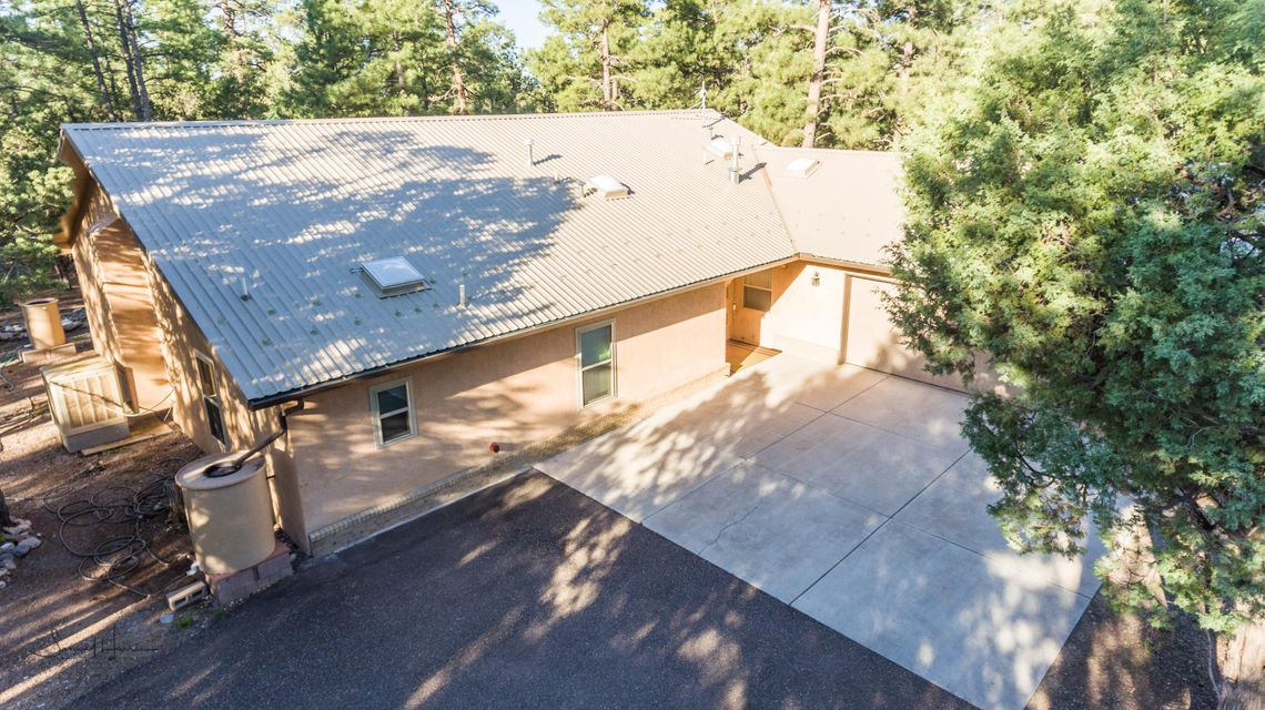 OPEN House 5-27-17 from 1 to 4. Imagine coming home to a place so beautiful, that you feel like you are at a retreat! This is one of the nicest lots in the east mountains - 2.5 FULLY fenced acres! When you are sitting out by the stream, all is good with the world! ON the WATER system!!! This well thought out home is nestled in The Tall Ponderosa Pines. Disability Access!!! Cut & Polished Concrete Floors, Cozy Pellet Stove. Large Covered Porch. Very Open And Spacious. Paved Roads Too!