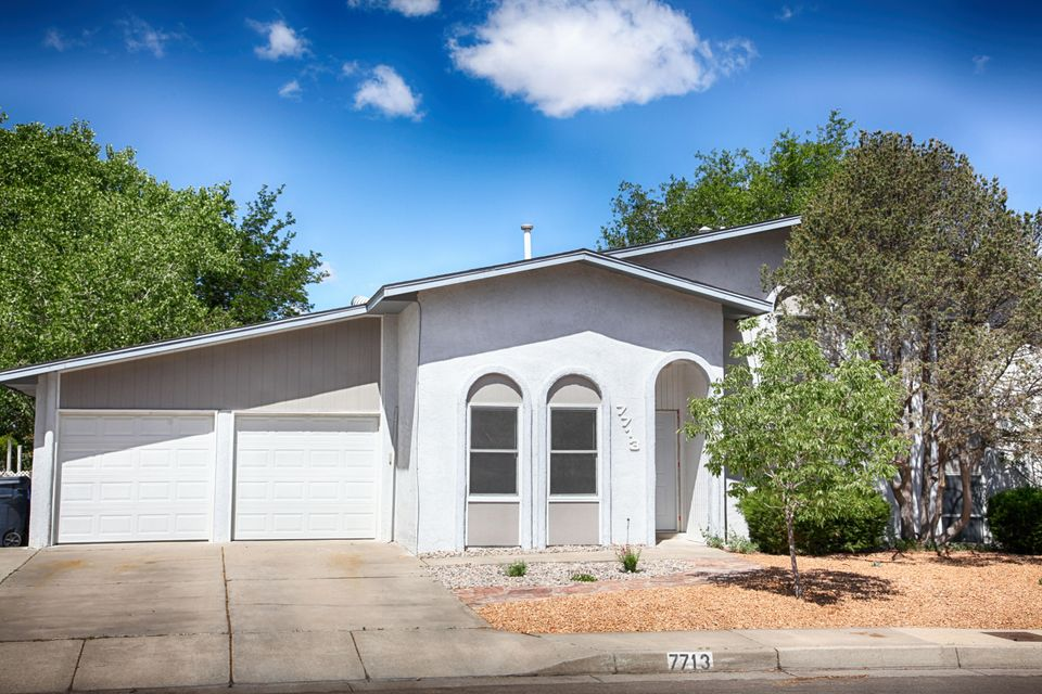 OPEN HOUSE Sat. 6/3 1-3pm. Stop on By! Looking for space? This great property has a HUGE backyard just waiting for your green thumb! And talk about LOCATION! Is there a better one? La Cueva School District. This beauty is located just off Paseo Del Norte and Wyoming. A hop-skip-roll or jump to the freeway and anywhere Albuquerque. FABULOUS shopping just down the street. This tri-level home boasts two nice size living areas and vaulted ceilings. The master is separated from the other THREE bedrooms. BRAND NEW ROOF! Newer carpet.  There is a pellet stove in the den that will warm the house. Pitched roof. Appliances convey with home! Call for your own personal tour!
