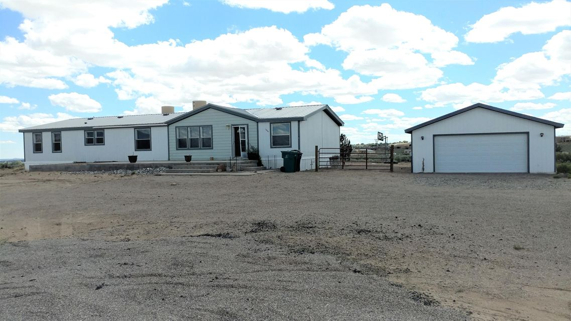 Rio Rancho, is waiting for you to call this your Home! This Home sits on an acre lot along with 4 beds, 3 baths, 2 car garage, 2 living spaces and much more! New Paint and carpet in all bedrooms. Must See, you won't be disappointed! Schedule your showing now!