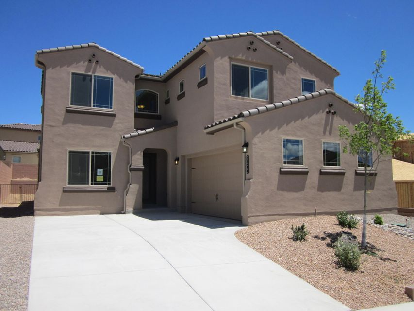 Green build New Mexico-Silver Level which is certified by an independentengineer. Tankless hot water on demand.Dual air conditioners to cool the houseefficiently. Family room with gas decorative fireplace that opens to granite kitchen island. 20'' inch floor tile in kitchen and family room with a staggered design.