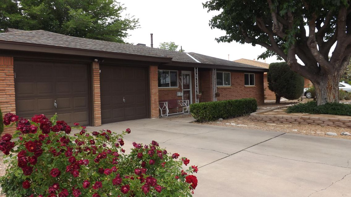 A gem in the northeast! Quiet street, and desireable neighborhood. Convenient to shopping, schools and restaurants. Updated kitchen and bathroom, stainless steel appliances, and landscaped front and backyards. Laminate floors, skylight, double-pane windows, 2 car garage and ample storage. Large backyard is a perfect place for a backyard get-together. A must see!
