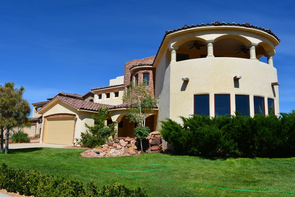 This is your dream house! Must see! An amazing luxury European Tuscan Style Custom Home in gated community! Top quality materials through out the house. Huge/heavy Regal Wrought Iron front door invite you into hand carved beams high ceiling open living area. Sparkling Diamond plaster finish walls, Travertine floor, Radiant heat, 2 units refrigerated air.Gourmet kitchen with granite slab counters. Two covered balcony with breath taking views! 2 master suites. one up and one down stairs are all with granite counter tops! Surround sound system and central vacuum system are ready to hook up. Energy efficient low-E glass Pella wood windows. Auto sprinkler and irrigation system front and back. Must see!