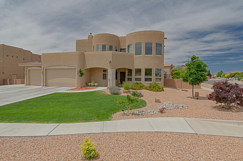 Masterful design and contemporary luxury are exclusively embodied in this custom Corinthian home at Cabezon. Set on a corner lot, this captivating home also offers an open balcony that provides breathtaking views of the Sandia Mountains. Entertain in style with the pergola, fully landscaped yard, gas fire pit and a covered patio with an inviting ceiling fan.The open living features soaring ceilings with stacked windows and a stone fireplace. The sleek and stylish kitchen features granite counter tops and all stainless appliances.  This home also boasts two master suites, a Jack & Jill bathroom setup, a gorgeous snail shower with dual heads, jetted tub, bedroom shelving conveying and a quaint loft with a linen closet.
