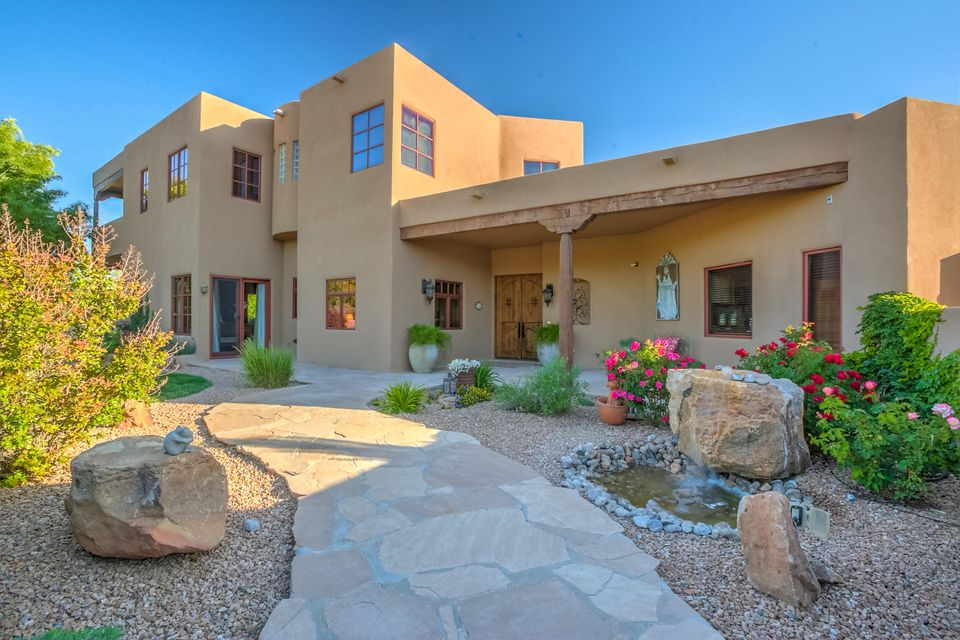 Gorgeous custom two-story Pueblo home located in the greenbelt of Corrales with easy access to the Rio Grande.  Home is on one acre,completely fenced in, with electric gate entrance.  Four spacious bedrooms all with walk-in closets plus office with built-in shelving.  Large elevator with 900 pound capacity. A fabulous chef's kitchen with large island, stainless steel appliances, large pantry and tall knotty Alder cabinetry.  Home features clay plastered walls, massive beams and high tongue and groove ceilings.  Open floor plan with large windows, french doors and abundant natural light.  Amenities include wet bar,elevator, radiant heat, refrigerated air, security system, surround sound, 4 car garage with bathroom, gardens, water features, balcony and incredible views.