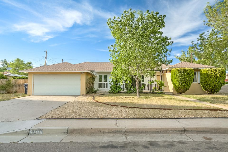 Spacious single story 3 BR home on oversized corner lot.  Features include:**Real hardwood floors**Wood burning fireplace**Skylights**Mature landscaping**2 living areas**Workshop in garage**Covered patio**Close to Uptown, Nob Hill, and I40**This is a unique home with lots of character!!