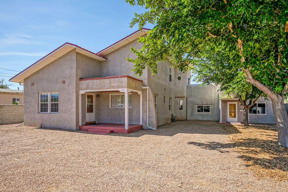 This  Remodeled 2 unit Adobe Charmer would be perfect for those needing a Multi-Generational Home! It's in a Quiet Neighborhood, Conveniently Located by Paseo del Norte off 2nd, 1 block from the New North Valley Steel Bender Brewery! The West Side Unit is heated by a High Efficiency Solar Buderas Boiler, & has all new thermal windows. It has 1-2 bedrooms & a LARGE attached Flex Room/Office with 2 half baths & a Wet Bar Area, perfect for any sort of business. The East side has 3 bedrooms with all wood & tile flooring on the main floor. Upstairs is the Master Suite with carpet & a tiled office/flex room. Home has a newer Red Metal Roof & a Foam Roof on the LARGE Flex Rm. There's also a detached 2 car garage w/2 attached small finished flex spaces. See attached floor plan. Lots of Potential!