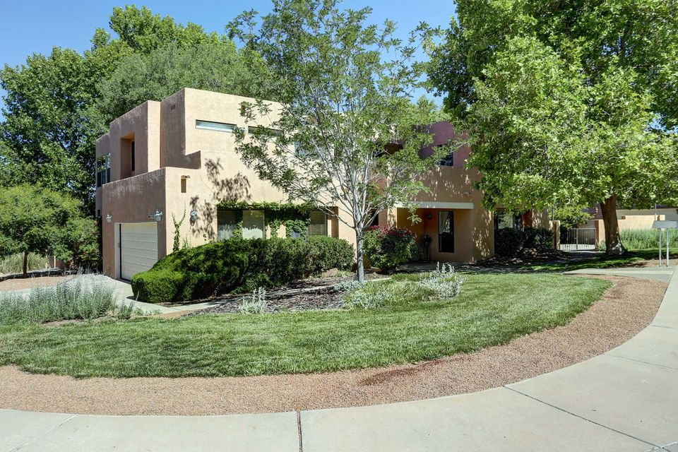 *Seller is offering a years worth of cleaning services, AND a years membership to Tanoan Country Club with purchase. Ask your realtor for more info!*Outdoors is a deck and grill, vines and trees, and lush green lawn. Inside, there are granite counter tops and stainless steel appliances, updated light fixtures, and soaring ceilings. In addition to the 4 bedrooms, there's a private office off the master, AND a separate den downstairs, for use as an office or music room, etc. Two upstairs balcony areas. Bluetooth surround sound, custom fireplace, and a huge laundry room with window. Almost every room has custom built-in bookcases. Eat in kitchen bar top and dining space, and beautiful sunroom connecting the family room to the outdoors. Spacious, comfortable, and filled with sunshine.
