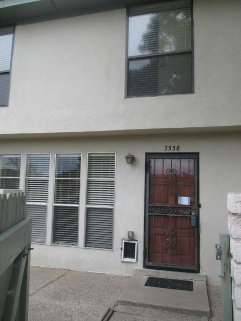 Adorable 1400 sqft Townhome conveniently located in the desirable NE Heights. Newer carpet and paint. Tiled kitchen and baths. Home has 2 HUGE bedrooms and 2 full baths plus 1 half bath and a 1 car attached garage. Refrigerated AIR! Enjoy the community pool and tennis courts and lush green grounds that surround this fantastic condo.
