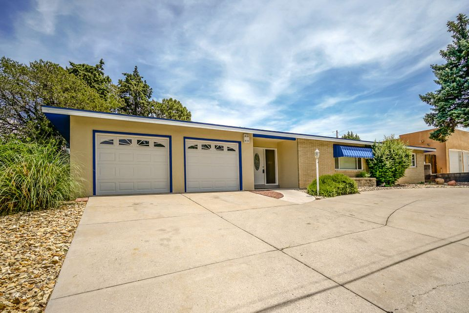 Mid Century Vibes in Altura Park! Be sure to see the 3D Tour! Fall in love with the unique character of this 3 bed, 2 bath home. Enjoy all season swimming with a full indoor pool and wet bar. Wood floors. Renovated studio space off the pool. Lush rear yard. Close to shopping, dining, UNM and Downtown.