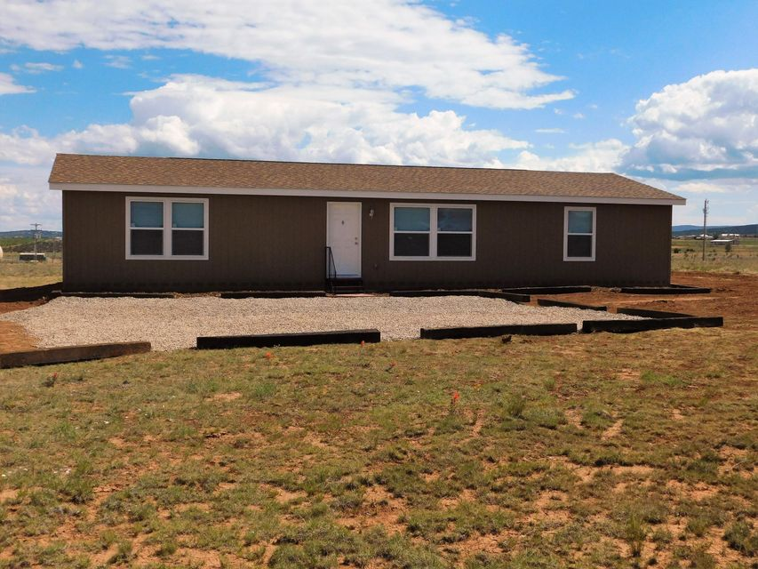 PRICE REDUCTION! Come see this brand new 2017 never lived in Karsten home on 5 acres in northwest Edgewood. Property sits at the end of a dead end road with beautiful views of South Mountain and the Sandias. Home boasts an open floor plan with 3 bedrooms and 1 3/4 baths. Home is on Entranosa water, natural gas and septic. Septic has been inspected and approved. 10 year warranty comes with the home along with a warranty on the new Frigidaire refrigerator and stove. House is countersunk on a permanent foundation and title has been deactivated. Property is close to schools, fire department, medical center and shopping.