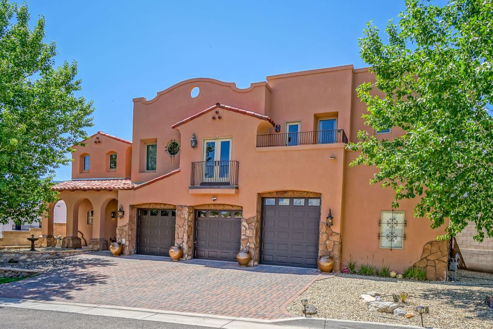 The definition of extravagance, check out this magnificent home! Located in a private gated community this home boasts 4 bedrooms, 2 of which have private balconies to enjoy the stunning Bosque and Sandia Mountain views, and 3 bathrooms giving everyone enough space to grow! As you walk through this home you'll notice the Old-World charm and high-end touches such as imported French double vintage doors, copper, gold and silver leaf accents, mosaic inlaid travertine floors and so much more! You'll surely be tempted to make use of the impeccable Thermador Stainless Steel Appliances that perfectly compliment the granite counters in the kitchen of your dreams. Feeling like you need more? Be sure to check out the 3D Tour and then stop by!