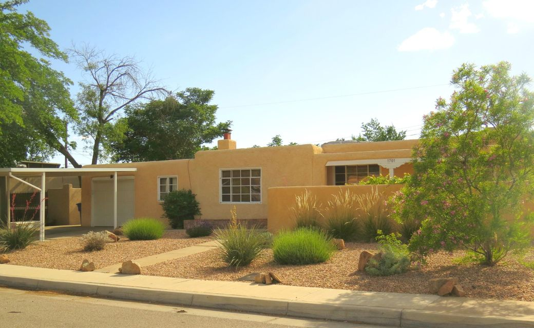 Location, Location, Location!  Cute, cozy and charming home minutes from upscale ABQ Uptown!  Inviting courtyard entry coupled with beautiful landscape provides lovely curb appeal. Freshly painted and new carpets recently installed in the 3 bedrooms, upgraded kitchen, 2 living areas and bonus room off the garage (not included in sqft). Large open backyard with storage shed provides plenty of Summer Fun options.  The master cool A/C is running and ready to keep the new home owners fresh this Summer.  This will go in a flash so check it out ASAP!