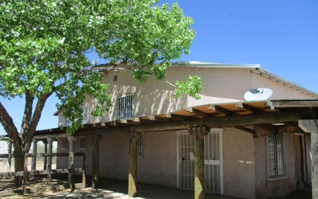 Looking for acreage? This single family home in the Land of Crespin Padilla is situated on almost 3 acres! The home, built in 1990, offers 2 bed, 2 bath, with a 3 car garage. The home is in need of some finishing touches. Opportunity to customize it to your specifications. Come check it out and make an offer!