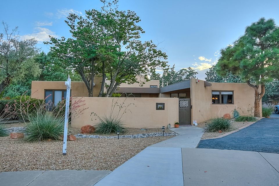 UPDATED Custom Home from the Office of Antoine Predock, Large .36 Acre Quiet CUL-DE-SAC Lot, Highly Desirable, Centrally Located LA SALA GRANDE Neighborhood W/ RV PARKING! SANDIA SCHOOL DISTRICT. Enter through the Lush Courtyard w/ a Large Covered Patio, Perfect Place for those Summer BBQ'S. Gorgeous Kitchen w/ Granite Countertops, Updated Cabinets, Stainless Steel Appliances, Huge Granite Island w/ Seating. OPEN FLOOR PLAN, ENTERTAINERS DREAM! Brick Floors, Fresh Paint, REFRIGERATED AIR, Tall Beamed Ceilings, Lots of NATURAL LIGHT. 3 Bedrooms plus a Game/Exercise/Media/Second Living Room/4th Bedroom! Large Bedrooms Separated from the Luxurious Master Suite & Updated Bath w/ its own private Courtyard. 3 Fireplaces, Large Private Low Maint. Backyard. MOVE IN READY! NO HOA!!!