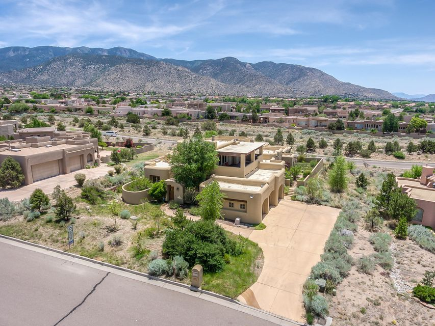 Nestled in the foothills community of High Desert w/ sweeping city & mountain views- first time this custom property is on the market! Private courtyard entry, tranquil floorplan features a zen interior atrium, inlaw/teen quarters, the library doubles as a formal dining room. Travertine + wood floors & handmade iron work. Kitchen- knotty alder cabinetry, wolf gas cooktop, subzero refrigerator, warming drawer, 2 pantries & over-sized island. Gorgeous wood detailing in circular breakfast nook. Main level MBR + nook for office/gym- light & airy MBA has 2 vanities, snail shower, separate jetted tub, large walk-in closet. Nearly a single level (1 room up-''the away room'') upper level, covered deck boasts spectacular panoramic views. Covered patios & lush landscape designed by Judith Phillips!