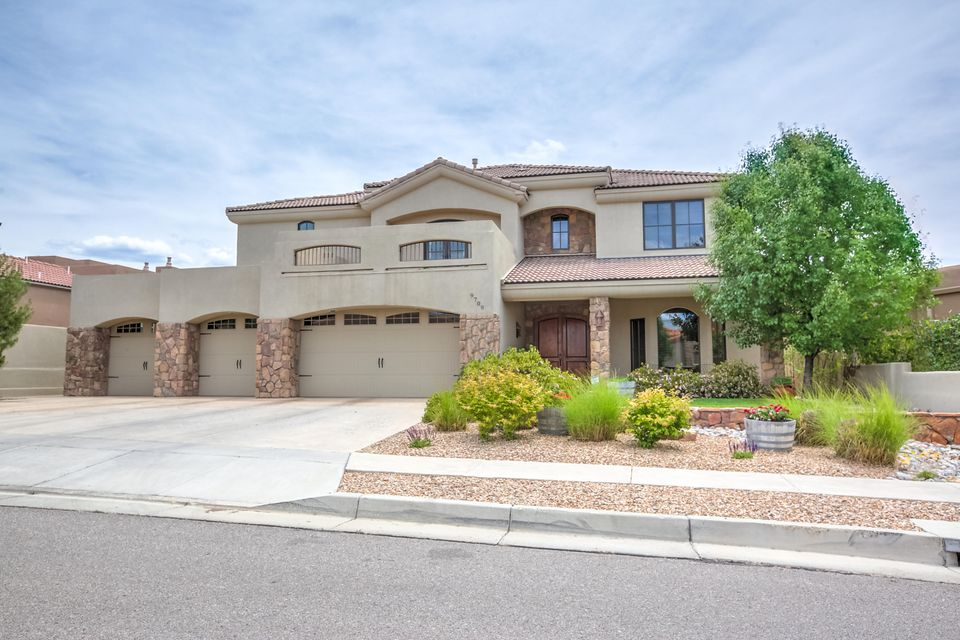 Nestled in the Highly Coveted gated Ocotillo Subdivision, this Masterpiece is sure to please. This home boasts 5 Bedrooms (In-Law Suite Downstairs w/ 3.4 Bath and Walk-in Shower), In-Suite Baths, a Media Room, a Travertine Staircase, and a 4 Car oversized Garage. The Kitchen is a Chefs Dream Come True w/ Thermidor Appliances, Granite Countertops, Granite Island, Alder Cabinets, a Custom Shelved Pantry, and a Copper Sink. Spacious Master Suite w/ Custom Shelving in Walk-in Closet, and a private cozy Fireplace. The Media Room w/ built-in Wet Bar is Large enough for the entire family. 3 Tiled patios will give everyone some space of their own. Also, if you need assistance getting to the second floor, simply use the Elevator.