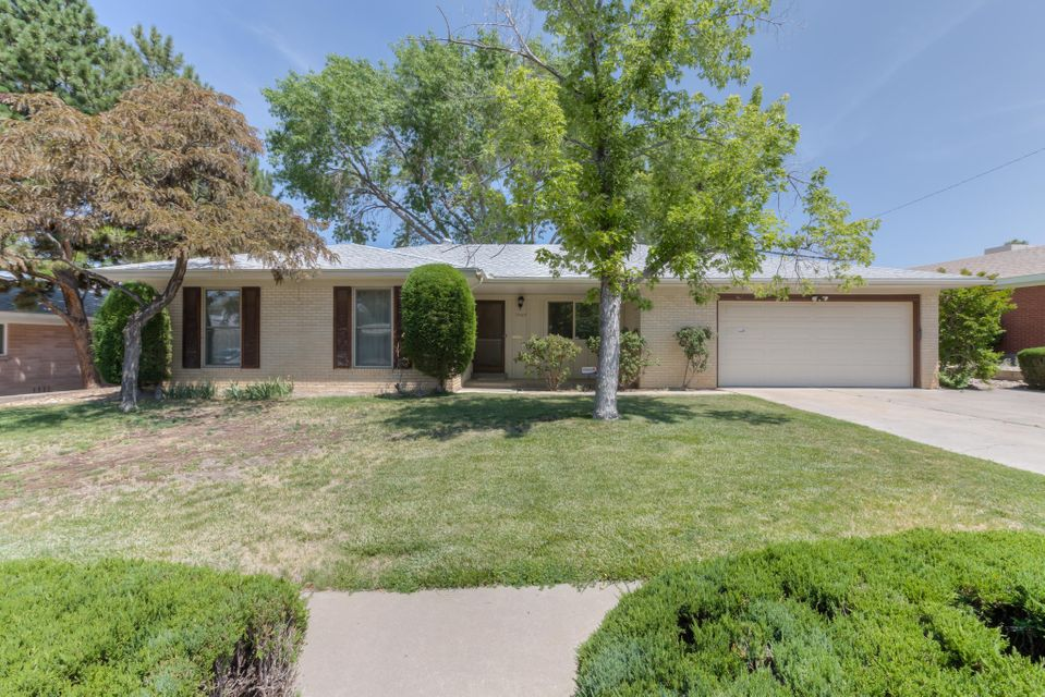 Great find in the Stardust Skies neighborhood with a park like backyard featuring grass, mature landscaping and a covered patio. Recent mechanical updates include Roof 2012, A/C evap cooler 2012, Vinyl windows 2014 and Furnace 2012. Two living rooms one with a fireplace, breakfast nook and formal dining room.  Spacious auxiliary bedrooms and master suite offers a walk-in closet. Built-in Storage shelves available in Garage. Updated kitchen with roll out shelves for convenient storage. Ideal central location with Quick access to Uptown Area, restaurants and stores. Also located in the Sandia HS district!