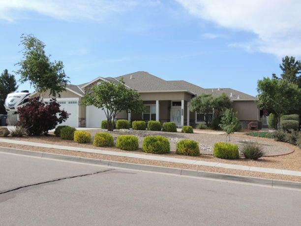 """This beautiful custom home has a bright open floorplan w/4 large bedrooms plus an office. Gourmet kitchen has custom cherry cabinets and Electrolux appliances. Large master suite has bath w/double vanities, large garden tub, and shower spa. Home has 6"""" exterior walls, high efficiency windows and extra insulation. State-of-the art monitored wireless alarm system, central vacuum system, custom wood floors, solid wood doors and 10 ft ceilings throughout home. Oversize 3-car garage w/9 ft high doors. Huge driveway with RV parking w/sewer, water, and electric hookups. Paved street with city water, sewer, electricity and cable.  Fully landscaped half acre lot, fenced 3-tier back yard w/water feature, 400 sqft studio/workshop, covered flagstone patio and 8 zone automatic irrigation system."""