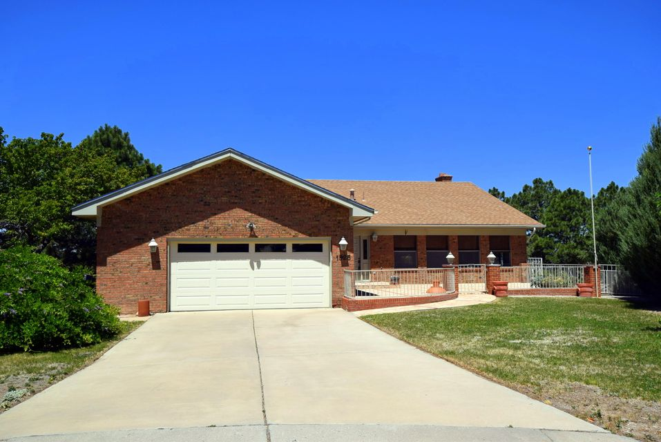 All BRICK Home with Spacious, Bright, and Open Floorplan with VIEWS on a cul-de sac .47 acre lot!!  You greeted with a formal entry that lead to a light filled, open kitchen with lots of counter space, 19.3 X 28.9 living room with brick fireplace, vaulted ceil, Dining area and VIEW deck.  Also, on this main level is the Master Suite with 3 closets!  Lower level has a large bedroom with 7.8 X 14.4 Walk-in closet and full bath then a 53.7 x 28.5 living area with fireplace - in-law quarters/ office/ teens paradise What are your needs!!  Oversized garage with work area.  Possible backyard access.  All in Four Hills with Golf course and Country Club.  There are endless possibilities with this Home and all under a hundred dollars per square foot! What are you waiting for - Come See TODAY!!