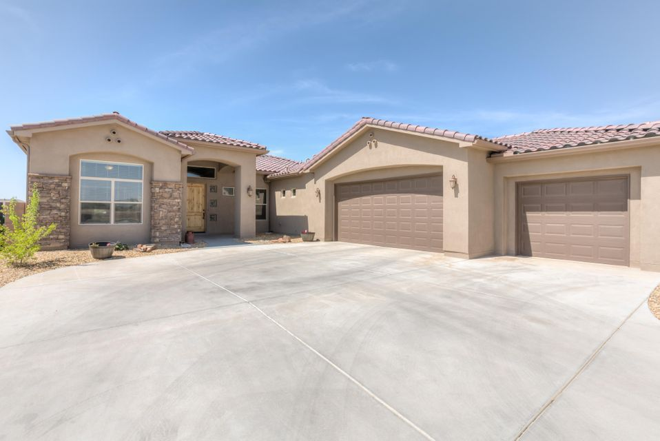 Why wait for a new build when you can move in right away to this gorgeous, custom 4 bedroom plus an office home with a 3 car garage.  Enjoy the stunning views from the spacious covered patio and completely landscaped half acre lot with fruit trees, native trees, garden beds and a walking path to the fenced in play area.  You will feel the luxury when you walk on the travertine floors and view the custom tiles, niches and granite countertops throughout the home. Lots of upgrades! Bring out your gourmet chef in the stylish open kitchen with large island, custom cabinets and upgraded appliances. When it is time to relax, soak in the garden tub in the exquisite master bath.  Every inch of this home is elegance at its best!