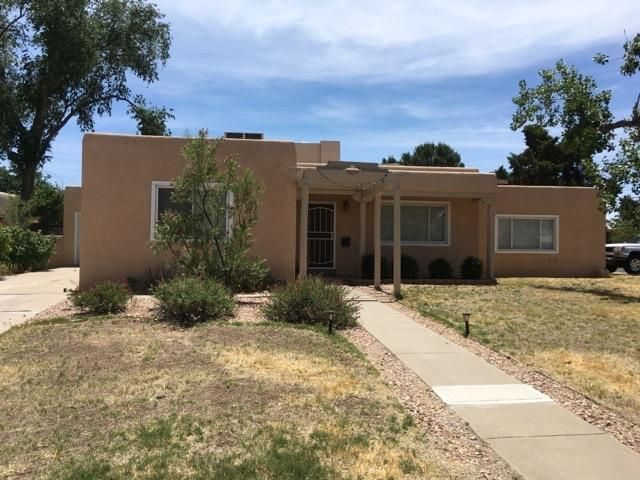 Location, Location, Location This one is hard to beat! Near UNM, Nob Hill, & easy freeway access. Spread out in this classy three bedroom, two bath home. Features include 1 car garage, updated kitchen, hardwood floors (the real stuff!) large sun room/flex space, living room, separate family room, plus a small office. Refrigerated air to keep you cool inside while cozy yard has endless possibilities outside. Serious seller! See it soon!