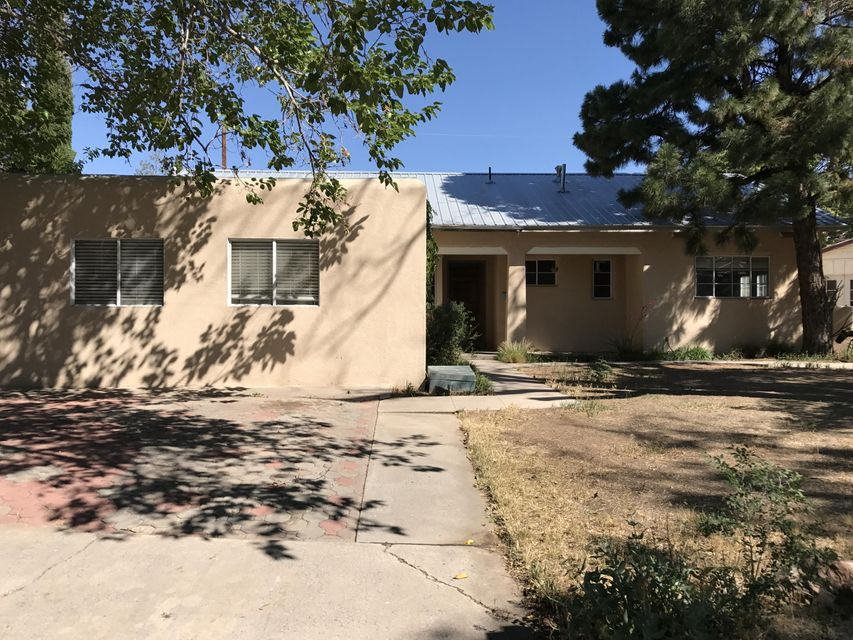 Beautiful NE home with 4 bedrooms and 2 baths with a new metal roof and stucco. The kitchen is perfect for a floating island and is quite spacious. Tranquil pine tree and bamboo features to patio and yard.