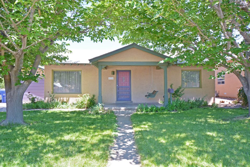 Lovely remodeled UNM Area home on shady lot located 1.5 blocks south of Summit Park. Newly Refinished hardwood floors in front section of house. Brick floors in spacious master bedroom. No carpet. Master bedroom features exposed adobe walls, tongue and groove ceilings, custom skylight, wood stove, huge walk-in closet and metal-clad wood casement windows. Solatube in kitchen plus newer countertops and stainless steel appliances. Kitchen pantry in service room. Updated bathrooms each with a solatube. Hot water baseboard heat with 4 year old boiler. New stack washer / dryer conveys with house. Updated electric box. Detached one car garage with opener plus bonus stuccoed storage building. Attractive landscaping with auto sprinklers + bubblers. Easy walk or bike to Medical and Law School