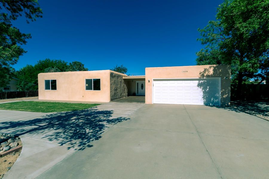 Delightful 3 bed 2.5 bath with double car garage featuring a huge master suite with walk in closet, jetted tub, rainfall shower, Brazilian Koa hardwood floors and custom tile. This house has backyard access for an RV and is ready to build a large shop or garage.