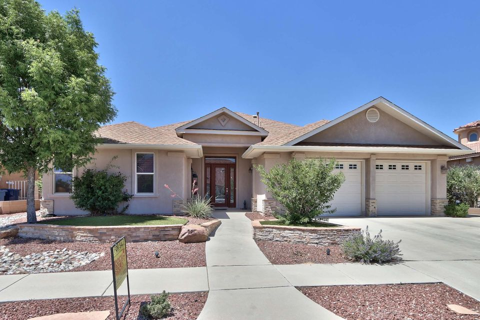 With 3 bedrooms, 2 full & one 3/4 handicap access bath, 2685 sq. ft. & 2 car garage this fantastic custom home has so much to offer! Raised ceilings & doors, wood & tile flooring throughout, large family room with fireplace opens to 265 sq. ft. covered patio. Many high-energy features including R-38 roof insulation, 2 x 6 exterior walls with R-19 insulation, dual pane, vinyl, tinted & low-e windows, 50gal. water heater with recirculation pump, insulated, finished garage & 24'' soffits for extra shading. Beautiful wood trim features, scroll work front door with sidelights & transom, hard-wired security system, sound system, stainless steel appliances & coved ceilings. Master bath includes separate shower, jetted tub, double sinks & his and her closets. Flagstone patio, 6 ft. wall & iron gat