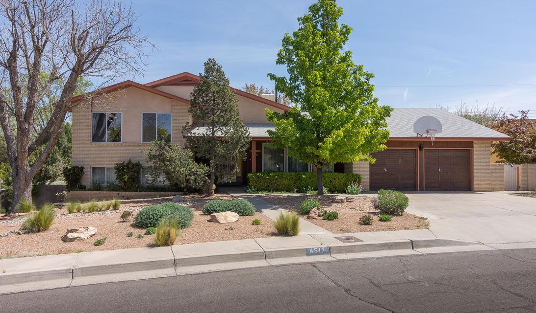 Welcome Home! A classic and quality built custom home lovingly maintained & cared for through the years, by the original owner! Located in the UNM area & a beautiful established neighborhood, Altura Park! Discover exquisite Park-Like Grounds, Brick Veneer, 2x6 construction, handsome Custom Crafted Cabinetry & solid wood doors! Spacious floor plan, perfect for family living and entertaining; including 2 living areas, formal dining room with built-in china cabinet. Large bedrooms with built-in desks; master with view balcony. Fabulous great room with exposed beams, cathedral ceiling, gas log fireplace & built-in book shelves/cabinets. Sliding door to the covered patio & gorgeous backyard with lush, mature landscaping & great views! Garden area! Generous 2 car garage with work shop area!