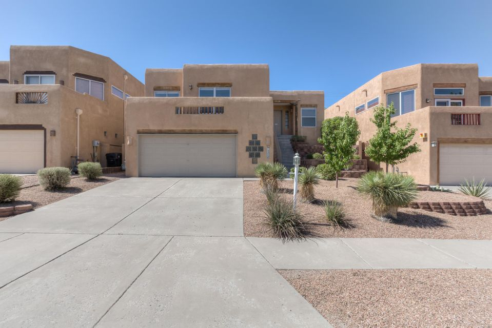 Bright, beautiful, and updated! Four Hills home with an open layout and a private backyard for outdoor living and entertaining. This home is minutes from I-40, Kirtland AFB and Sandia Labs, and convenient to shopping, movies, and some of the city's best walking/running/cycling trails. Beautifully updated kitchen and bathrooms, and a patio that screams VIEWS! Make this home!