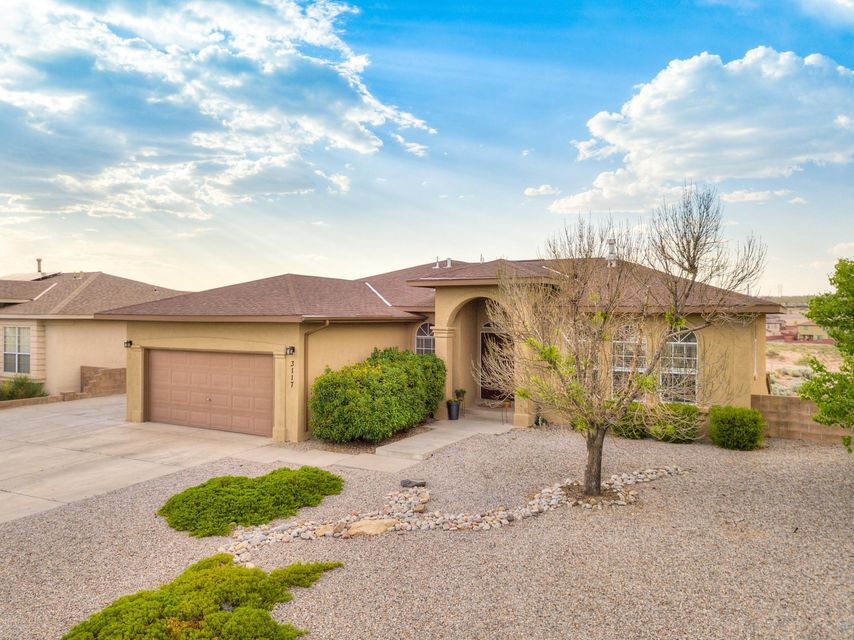 Hurry to see this stunning home because it is priced to sell! Located in a highly desired area of Rio Rancho, a quiet spot in close proximity to shopping and schools. It features a split level floor plan with a giant master suite on the upper level. The remaining 5 bedrooms as well as a second living area is on the  lower level. Spectacular views from the upper balcony will give you a first row seat to the yearly 4th of July firework show. Laminate wood and tile throughout, stainless appliances and a dog run. Come see this home before its gone!