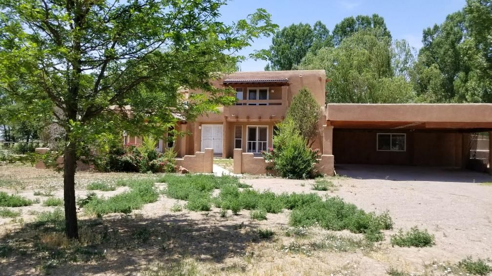 Beautiful country living. Come take a look the home features spacious bedrooms, 2 fireplaces, fully fenced lot, carport, room for horses and animals. This is a Beautiful property.