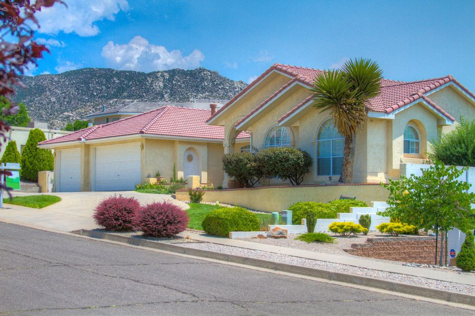 Exceptional one story home located in Albuquerque Foothills!  Gorgeous Landscaping, Open Floor Plan, Granite Counter Tops, Spacious Bedrooms, and an  Over-Sized 3 car Garage with a bonus Workshop Room. Your Dream Home Awaits!