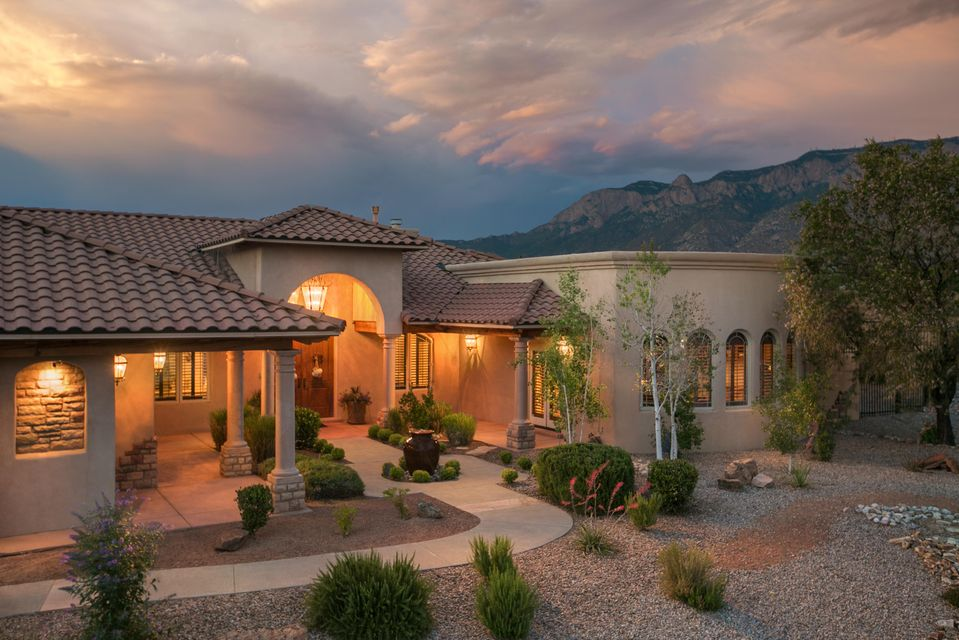 Custom single level Home in exclusive N. ABQ Acres w/OUTSTANDING views!This dream home is a Slice of Paradise showcasing over 5800SF;Looks like it's out of the pgs of Better Homes&Garden;This Immaculate 6 BDR/6 BATH/3 CG home delivers open concept floorplan showcasing arch accents,columns,gleaming tile&hardwood flooring&lush carpet in BDRMS,3 Refrig/Heating systems(2units replaced 2016).Gourmet Kitchen features granite counters/island,prof grade appliances,custom cabinetry,built-in Refrig just to name a few.Grand Mstr-Ste affords every luxury expected+Renovated Spa-Like MSTR-BTH delivering many amenities incl Steamroom.Beautifully landscaped backyard delivers tranquil waterfall, in-ground trampoline, playground,hot tub & crystal blue pool ALL transform this bkyd into a luxury retreat!