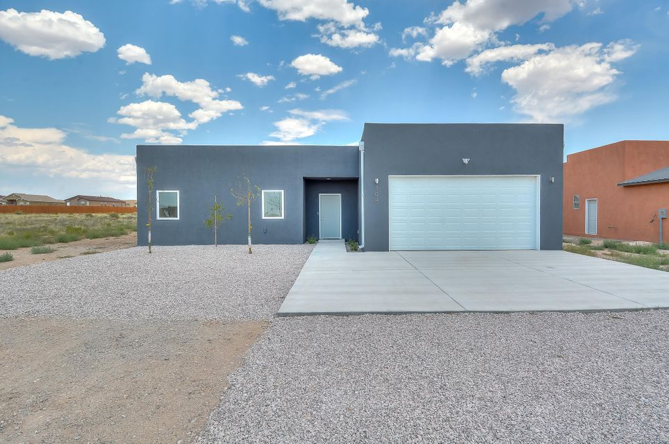 Contemporary custom built home located on a large 1/2 acre lot with splendid mountain views in the heart of Rio Rancho. Home features a functional floor plan with 3 bedrooms and 2 bathrooms. Beautifully polished concrete floors flow throughout the home. Modern kitchen with high-end Berkeley Woodworking white cabinetry, quartz countertops, upgraded stainless steel appliances and range hood. Spacious living area open to kitchen. Master suite with private bath. Bath hosts a walk-in shower with tile surround, custom vanities with his/hers sinks and a large walk in closet. Outside enjoy sitting under the covered patio and the breathtaking mountain views!