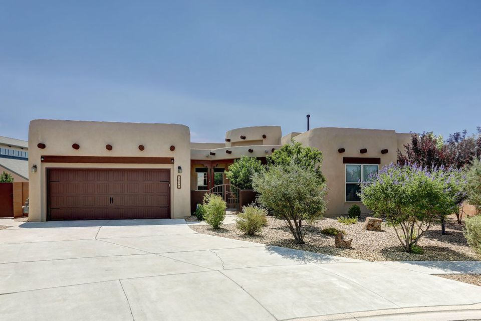 Welcome to this Cabezon Stunner! Luxurious and great location, the duo that rarely comes along. This Wallen Built Home offers 2 master bedrooms and a wonderful floor plan. The Large Wooden Doors, Ceramic Tiles, Butler's Pantry, and Fine Finishes throughout the house will leave you in Awe! To top it off the back yard is facing the Sandia's and built for entertaining! Featuring a Built in Gas Grill, Synthetic Grass, and Beautiful Landscaping! Come join the beautiful community of Cabezon!