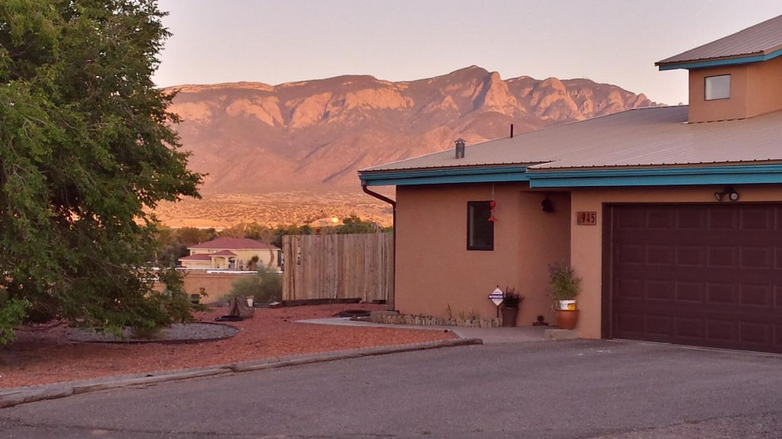 LOCATION, LOCATION, LOCATION!  Looking to be near ABQ yet LIVE away from THE HUSTLE & BUSTLE? This one of a kind home has a rural feel and ONLY 10 minutes from ABQ! Easy access to I-25, the Rail Runner and shopping!  Great place to unwind after a long day at work!Beautiful home on a 1.11 Acre Lot west of the river in a GREAT location that offers livestock zoning AND fabulous views of The Sandia Mountains & The Bosque.  This beauty offers a metal roof and beautiful stucco (both only 5 years old), workshop shed and a RV 30-amp hook-up with sewer dumps. Large Master bedroom on main level, beautiful Hardwood floors and Oak trim throughout, Gas stove, upgraded bathrooms, new carpet, lots of storage, spacious Sunroom & a low maintenance fenced backyard with unobstructed views of the Sandias.