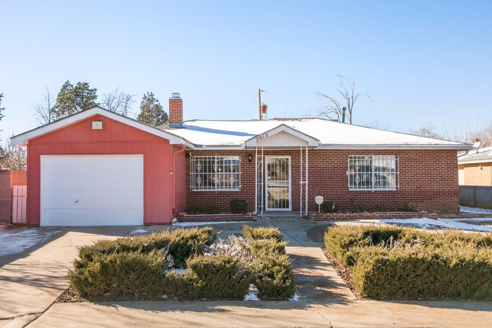 A Charming Single Story Brick Home just a mile away from all the Major Malls & Entertainment in Albuquerque's Vibrant Uptown Area! Home Features 1,723 sqft, has a 175 sqft. Sunroom (sunroom not included in the square footage of the home), 3 bedrooms, 1.3/4 baths, 2 car garage (double deep), fruit trees, convenient circular driveway, evaporative cooling, central force air heating, mini gazebo, convenient access to main highway, close to schools, place of employment, public transportation and much more...