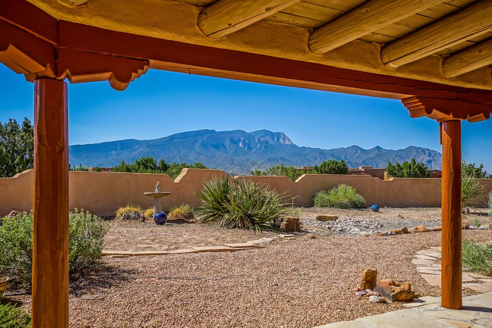 This High Quality Traditional SW Style Home is a Rare Find on Top of a Ridge with Gigantic Views of Sandia Mtn. Unsurpassed Quality Amenities include Exposed Adobe Walls and Metal Clad Thermal Wood Windows throughout the home, Sub Zero Refrigerator & Gorgeous Cherry & Walnut Cabinets in the Efficient Kitchen. Generously sized rooms include an Office/Den/Flex Room. Master bath includes a Bidet. Covered Patios in the Front Courtyard & off the Dining Room offer You Outdoor Pleasure. Updates include New Stucco, 2 New French doors, all exterior Vigas Copper Clad, Exterior Wood Freshly Painted, Drip System Repaired. From the Gleaming Saltillo Tile Floors to the Soaring Viga & Split Cedar Ceiling in the Living Room, this Remarkable Home will assure you a Lifetime of Comfort, Serenity and Peace.