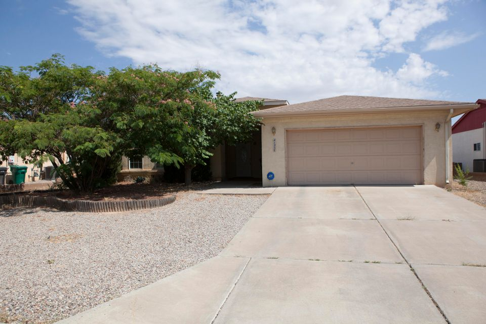 Come home to this comfortable and peaceful abode. Located in the heart of Rio Rancho, this inviting home offers quick and easy access to groceries, gas, restaurants/pubs, fitness, parks, and walking trails. Home features include an open floorplan for entertaining or keeping an eye on the little ones, large private yard xeriscaped for ease of maintenance, wood-burning fireplace, and solar power, all located in an established quiet neighborhood. Convenience and comfort make this home a standout amongst the rest.