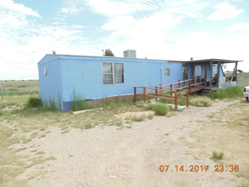 Five acres with full utilities, good views lots of room for construction, recreation, horses etcetera.The home is older needs TLC.