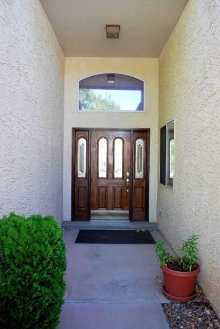 Huge Price Reduction !!!  Custom-built One owner home with Sandia Views! Large Corner lot. 4 bedrooms/ 2 1/2 baths. Formal dining, formal living, plus a family room with fireplace. Eat-in kitchen for casual dining looking out to the large backyard and Sandias. Fully finished basement with one bedroom and a large area for playroom, workshop, or whatever! Large kitchen has new never-used dishwasher and gas stove! Separate laundry room leads to over-sized 2 car garage. Covered backyard patio and large fenced yard. Full Home Inspections completed and available.  Sellers offering $4000 flooring allowance with acceptable offer!