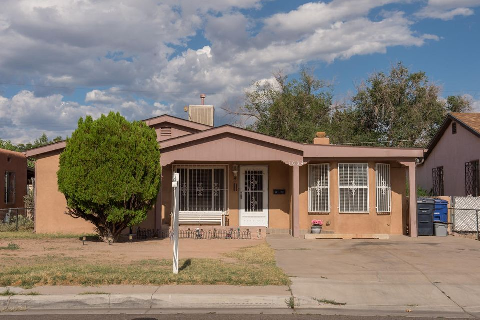 Wonderful home near UNM ready for new owners!  This well cared for 2 bedroom, 1 bath home is located close to UNM/CNM, KAFB,  downtown, restaurants and freeway.  Close enough to enjoy Nob Hill without the Nob Hill price.  Walk to a Isotopes game, Lobo Football game or the Pit. Home has newer roof, hot water heater and evaporative cooler (2015).  Two living areas for entertaining. The large family room has a wood burning fireplace.   Kitchen is updated and all appliances stay.  Ceramic tile throughout high traffic areas and original wood floors under the carpet in bedrooms.  Large covered patio perfect for BBQ's or to just unwind at the end of the day.  Lots of storage in utility room and shed in backyard conveys.  The yard is fully fenced and has a large side area for easy access.