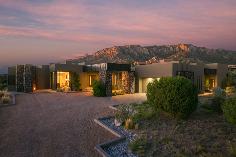 Presenting a rare contemporary find in the Mountain Highlands in High Desert.  Blending the highest level of construction with green in mind and attention to detail with a distinctive location that seamlessly fits in the surrounding natural landscaping.  Meticulously maintained this property boasts an impressive one level floor plan on .83 acres with an open living concept, a chef's kitchen with 12 foot ceilings open to the great room with amazing glass doors that disappear into the walls to maximize the views and increase outdoor living concepts. A formal dining space with gorgeous city views. Has a casita with a full bedroom and a garage that is a car collectors dream.  This luxury community is known from it's stunning mountain and city views and proximity to miles of mountain trails.
