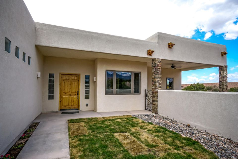 WOW!! Spectacular Custom Built Home in the desirable Anasazi Meadows Subdivision. Breathtaking mountain and mesa views. 2481 square feet with 3 bedrooms, two bath, three car finished garage w/ epoxy floor. Gourmet kitchen w/ stainless steel appliances, granite counter tops, high end custom cabinetry and an oversized walk in pantry. SIP Wall construction on all exteriors walls, polished concrete floors in all areas with the exception of bedrooms that have stunning Brazilian Koa wood floors. 2 gas fire places trimmed with granite in living area and one in the master. Master bath w/ an amazing spa like feel, a walk in shower with it's unique design. High Ceilings, Vigas w/ T&G. Dual heating radiant and forced air, refrigerated air conditioning. On demand domestic hot water with recirculation.