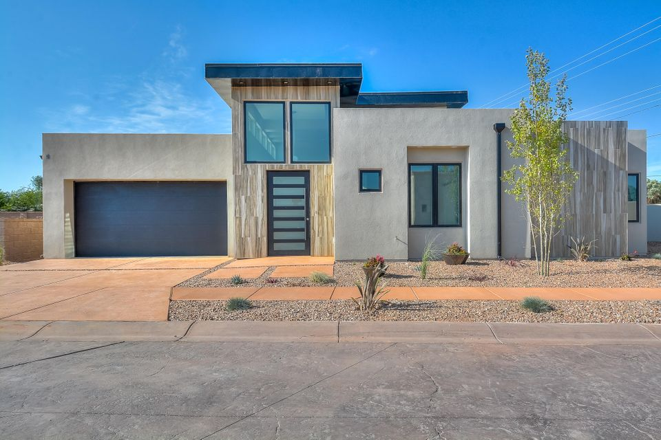 Stunning contemporary Roku Development    home located in the prominent Via Villegas neighborhood near the North Valley! Home features 2,107 sf of the most luxurious amenities throughout. 3 bedrooms, 2.5 bathrooms and an office! High-end kitchen with beautiful custom white cabs and crown molding, granite countertops, marble backsplash, cooktop, built-in double oven and microwave, kitchen bar with a ship lap accent! Huge family room with custom floor to ceiling fireplace! Master with bath. Bath hosts a gorgeous walk-in shower with custom tile surround and dual shower head, dual sinks and a large walk-in closet with custom shelving!